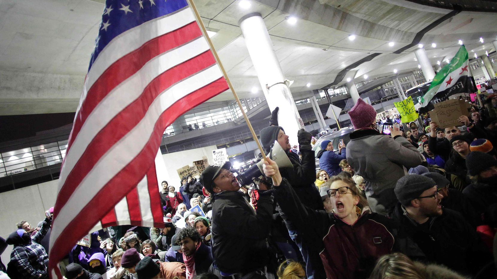 Demonstrators protest agaist President Trump's executive immigration ban at Chicago O'Hare International Airport on January 28, 2017.
