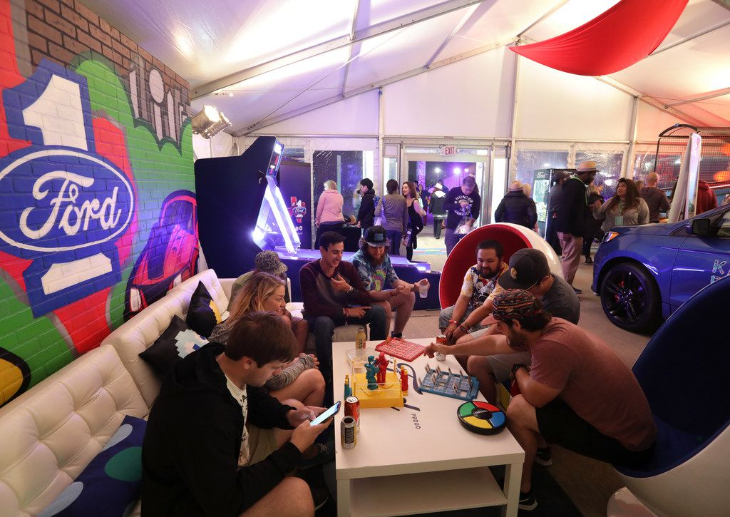 Guests play games in the Ford arcade tent during Kaaboo Texas at AT&T Stadium in Arlington, TX, on May 10, 2019.