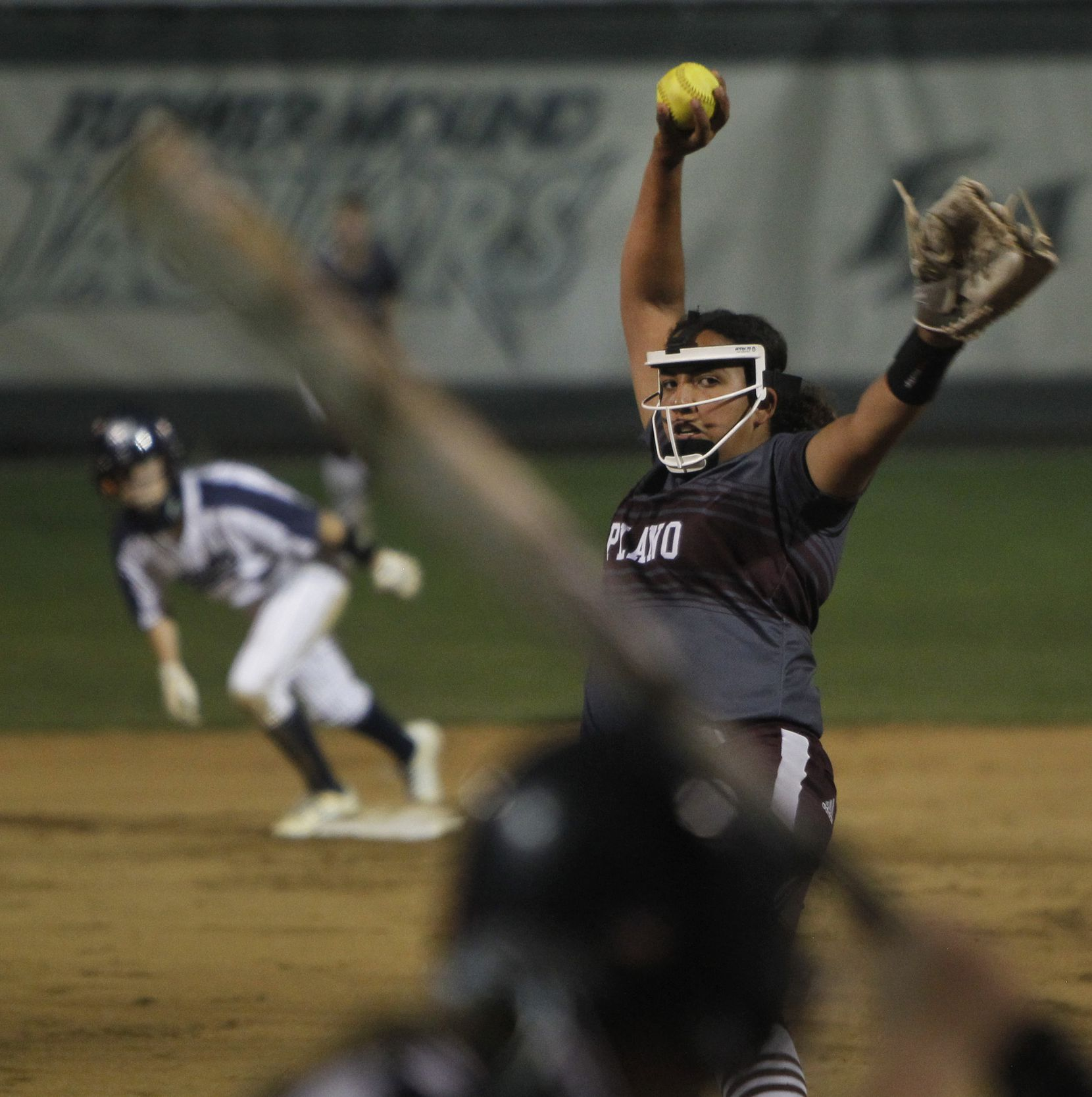 Plano pitcher Jayden Bluitt (20) prepares to deliver a pitch to a Flower Mound batter during the bottom of the 2nd inning of play. The two teams played their District 6-6A softball game at Flower Mound High School in Flower Mound on March 23, 2021. (Steve Hamm/ Special Contributor)