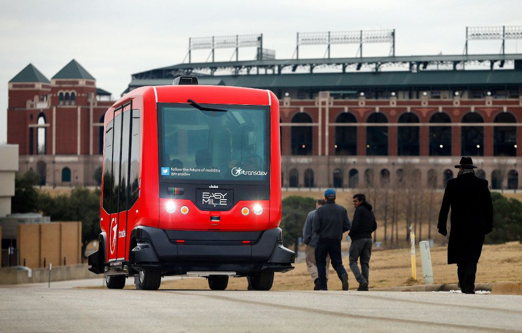 Alliance for Transportation Innovation's  EZ-10, a six-seat, self-driving shuttle, ferries passengers from a set location on a closed course near Globe Life Park in Arlington. City of Arlington and area officials rode the programmable shuttle from the Arlington Convention Center to a parking lot. Arlington has been named a national Automated Vehicle Proving Ground by the U.S. Department of Transportation.