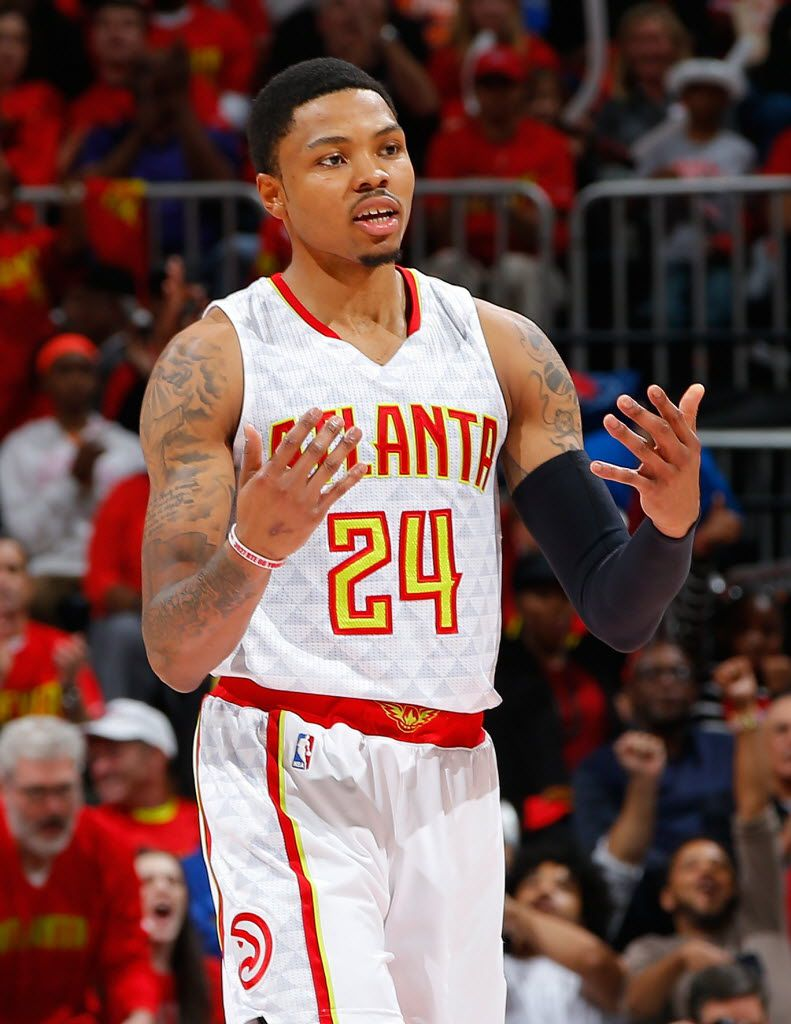ATLANTA, GA - MAY 06:  Kent Bazemore #24 of the Atlanta Hawks reacts after hitting a three-point basket against the Cleveland Cavaliers in Game Three of the Eastern Conference Semifinals during the 2016 NBA Playoffs at Philips Arena on May 6, 2016 in Atlanta, Georgia.  NOTE TO USER User expressly acknowledges and agrees that, by downloading and or using this photograph, user is consenting to the terms and conditions of the Getty Images License Agreement.  (Photo by Kevin C. Cox/Getty Images)