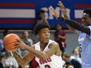 SMU guard Kendric Davis (3) looks to pass around Tulane guard Teshaun Hightower (5) during the second half of an NCAA basketball game at Moody Coliseum on Saturday, Feb. 1, 2020, in Dallas. SMU won the game 82-67.