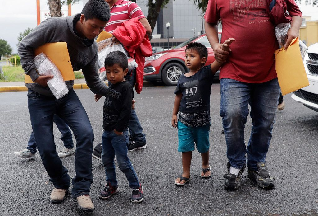 Young immigrants arrive with their parents at the Catholic Charities Rio Grande Valley after they were processed and released by U.S. Customs and Border Protection on Tuesday, June 19, 2018, in McAllen.
