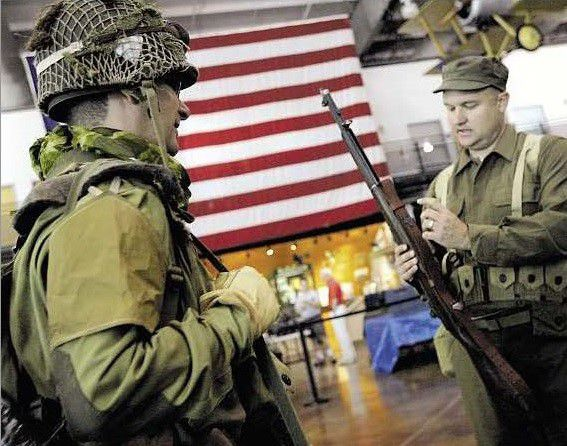 A photograph of Les Young and Aaron Seamster dressed up as World War II soldiers at the Frontiers of Flight Museum, published on June 7, 2009.