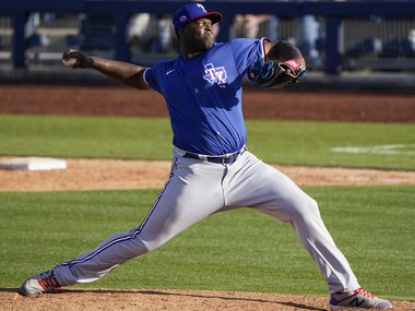 Texas Rangers pitcher Demarcus Evans pitches during the ninth inning of a spring training game against the Seattle Mariners at Peoria Sports Complex on Sunday, Feb. 23, 2020, in Peoria, Ariz.