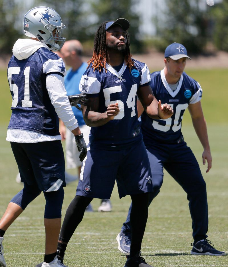 Dallas Cowboys' Kyle Wilber (51), Jaylon Smith (54) and Sean Lee (50) motion through defensive drills during an NFL football organized team activities practice at the team's training facility, Wednesday, May 24, 2017, in Frisco, Texas. (AP Photo/Tony Gutierrez)