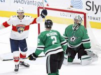 Florida Panthers center Alex Wennberg (21) celebrates center Frank Vatrano's overtime goal on Dallas Stars goaltender Anton Khudobin (35) at the American Airlines Center in Dallas, Tuesday, April 13, 2021. The Stars lost, 3-2.
