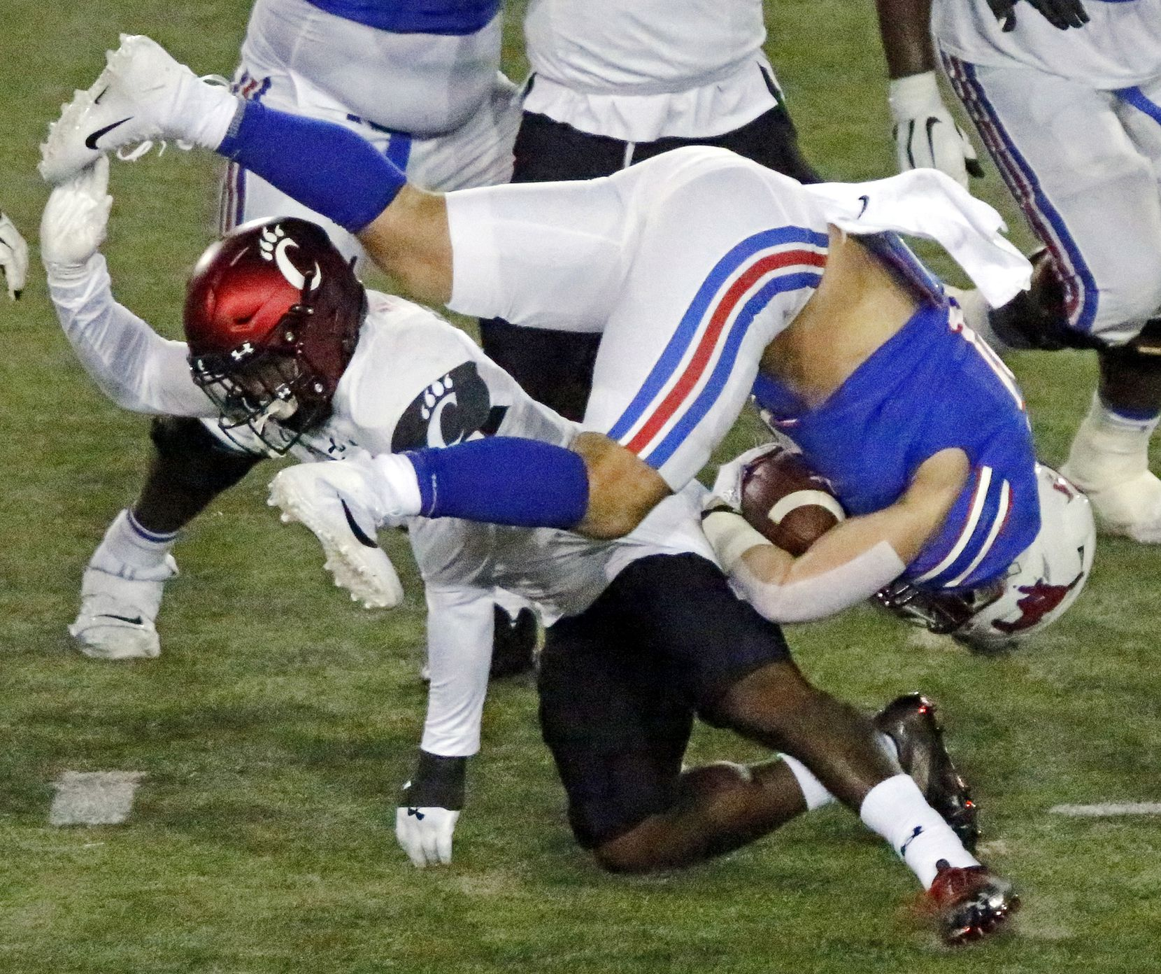Southern Methodist Mustangs running back Tyler Lavine (31) is upended by Cincinnati Bearcats linebacker Jarell White (8) during the first half as SMU hosted Cincinati University in an AAC football game at Ford Stadium in Dallas on Saturday night, October 24, 2020. (Stewart F. House/Special Contributor)