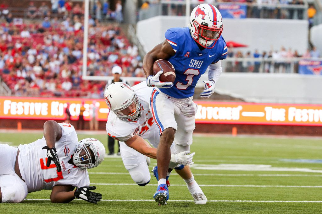 Southern Methodist Mustangs wide receiver James Proche (3) carries the ball to score a touchdown past Houston Baptist Huskies guard Emmanuel Mann (97) and linebacker Kyle Bowling (25) during the first half of an NCAA football game between Southern Methodist Mustangs and Houston Baptist on Saturday, September 29, 2018 at Ford Stadium in Dallas.