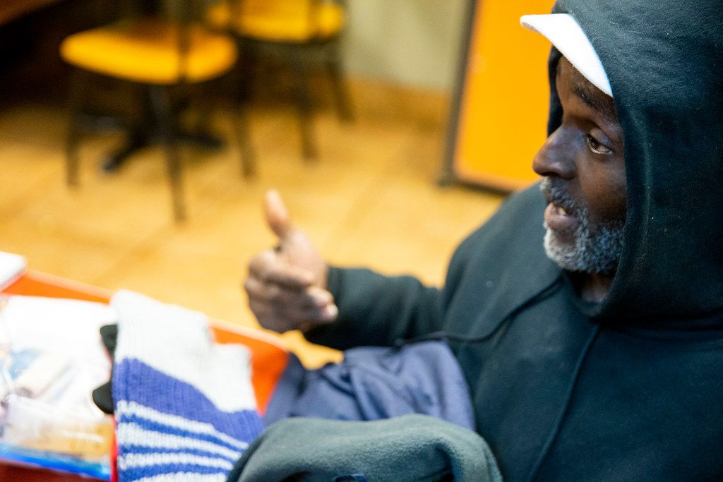 Gerald Harris talks to Ikenna Mogbo during the annual homeless count in Dallas on Thursday, Jan. 24, 2019. Harris has been homeless for almost a decade.