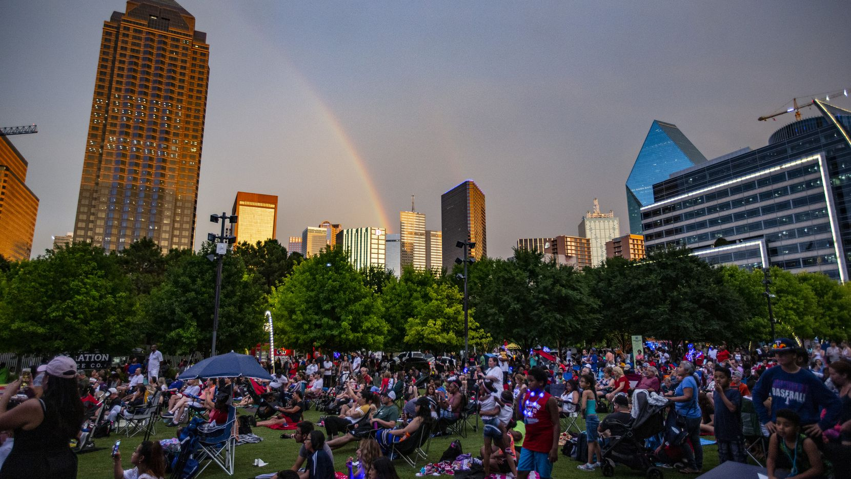 A rainbow appears over downtown Dallas after rain showers passed through during Klyde Warren Park's Independence Day Celebration on June 29.