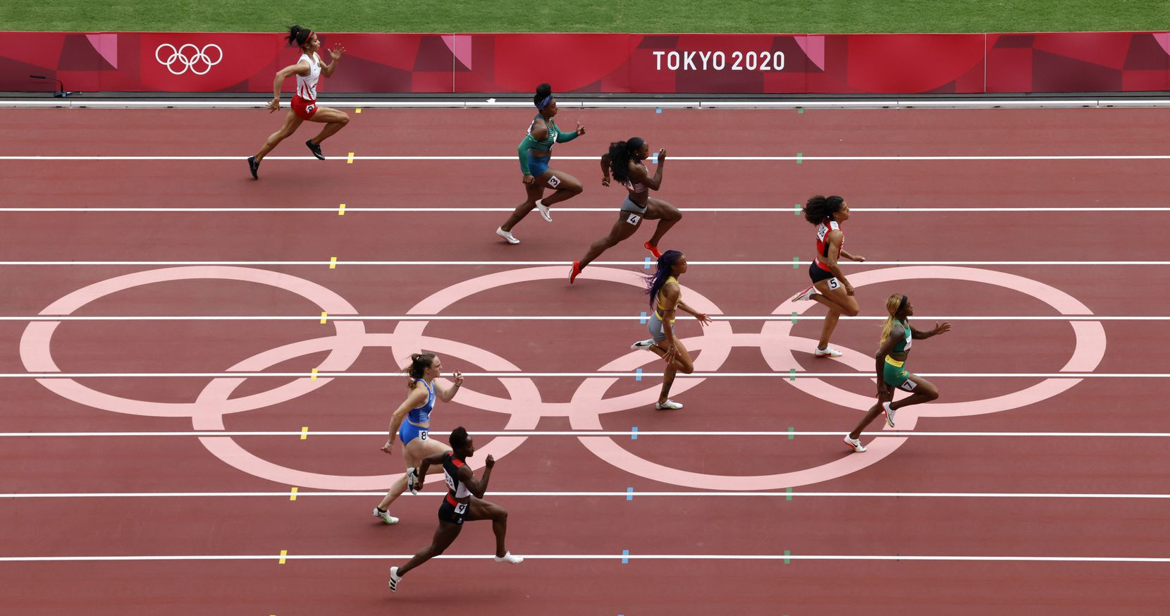 Jamaica's Elaine Thompson-Herah takes the lead in a women's 100 meter race during the postponed 2020 Tokyo Olympics at Olympic Stadium, on Friday, July 30, 2021, in Tokyo, Japan. Thompson-Herah finished with a time of 10.82 seconds to advance to the next round. (Vernon Bryant/The Dallas Morning News)