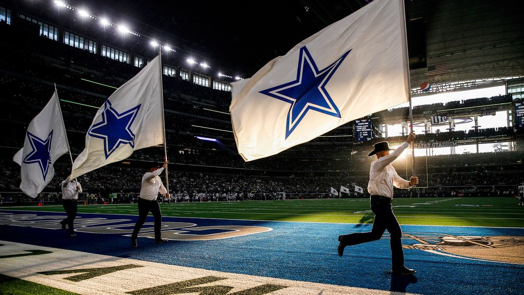 The Dallas Cowboys flag team fly through the end zone following a first half touchdown in an NFL matchup between the Dallas Cowboys and the Los Angeles Rams on Sunday, Dec. 15, 2019 at AT&T Stadium in Arlington, Texas.