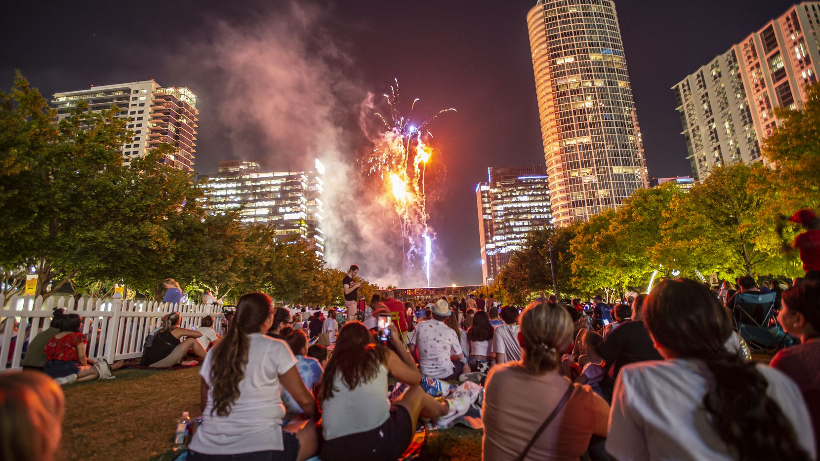 Fireworks light up the skyscrapers of downtown and Uptown during a Fourth of July celebration at Klyde Warren Park, June 26, 2021.