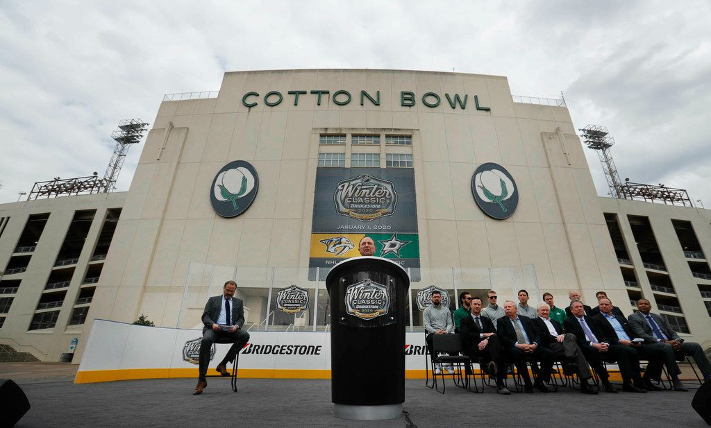 NHL commissioner Gary Bettman speaks from the podium with others looking on during a news conference outside the Cotton Bowl in Dallas, Wednesday, March 20, 2019. Bettman and the group were on hand to announce the NHL Winter Classic hockey game between the Nashville Predators and the Dallas Stars to be played Jan. 1, 2020, at the Cotton Bowl in Dallas.