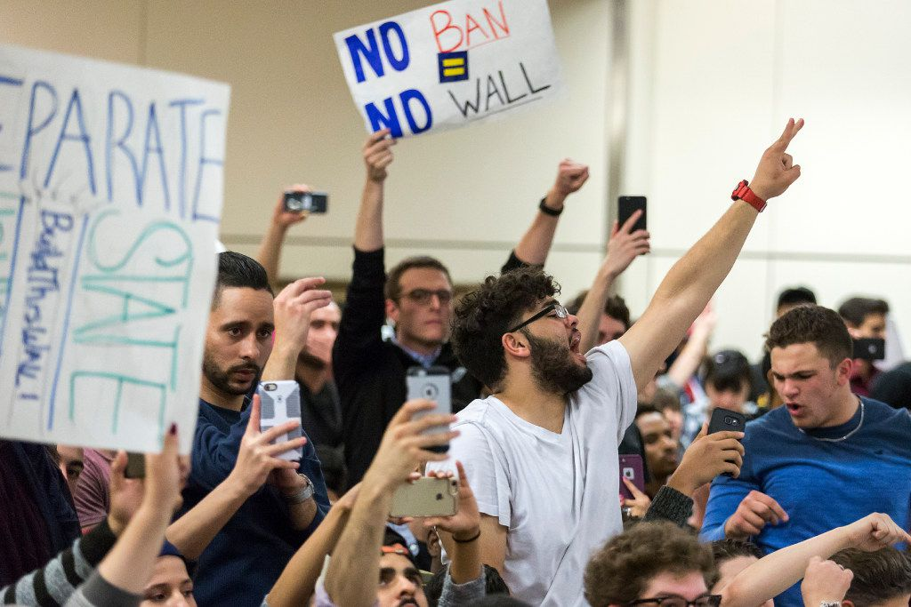 Protestors celebrate after organizers announced an end to the demonstration at DFW International Airport in opposition to President Donald Trump's executive order barring certain travelers on Sunday, Jan. 29, 2017. (Smiley N. Pool/The Dallas Morning News)