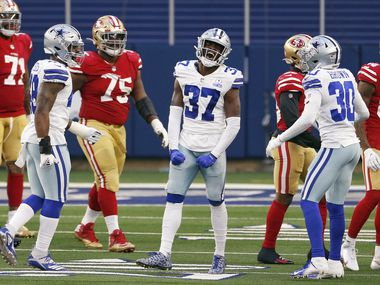 Cowboys safety Donovan Wilson (37) celebrates after intercepting a pass intended for 49ers tight end Jordan Reed during the fourth quarter of a game at AT&T Stadium on Sunday, Dec. 20, 2020, in Arlington.