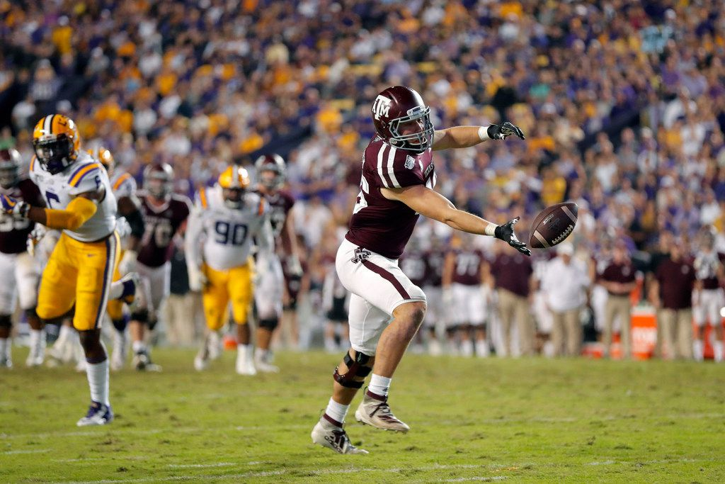 Texas A&M tight end Ryan Renick (46) can't pull in a pass during the second half of the team's NCAA college football game against LSU in Baton Rouge, La., Saturday, Nov. 30, 2019. LSU won 50-7. (AP Photo/Gerald Herbert)