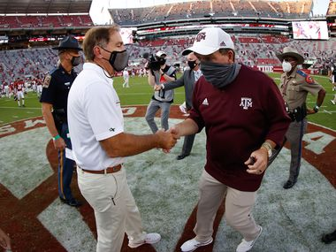 Nick Saban of the Alabama Crimson Tide shakes hands with Jimbo Fisher of the Texas A&M Aggies after the game on October 3, 2020 at Bryant-Denny Stadium in Tuscaloosa, Alabama.
