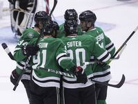 Players celebrate Dallas Stars center Tyler Seguin's (91) score during the first period of a Dallas Stars home opener against the Los Angeles Kings on Thursday, Oct. 21, 2021, at American Airlines Center in Dallas.