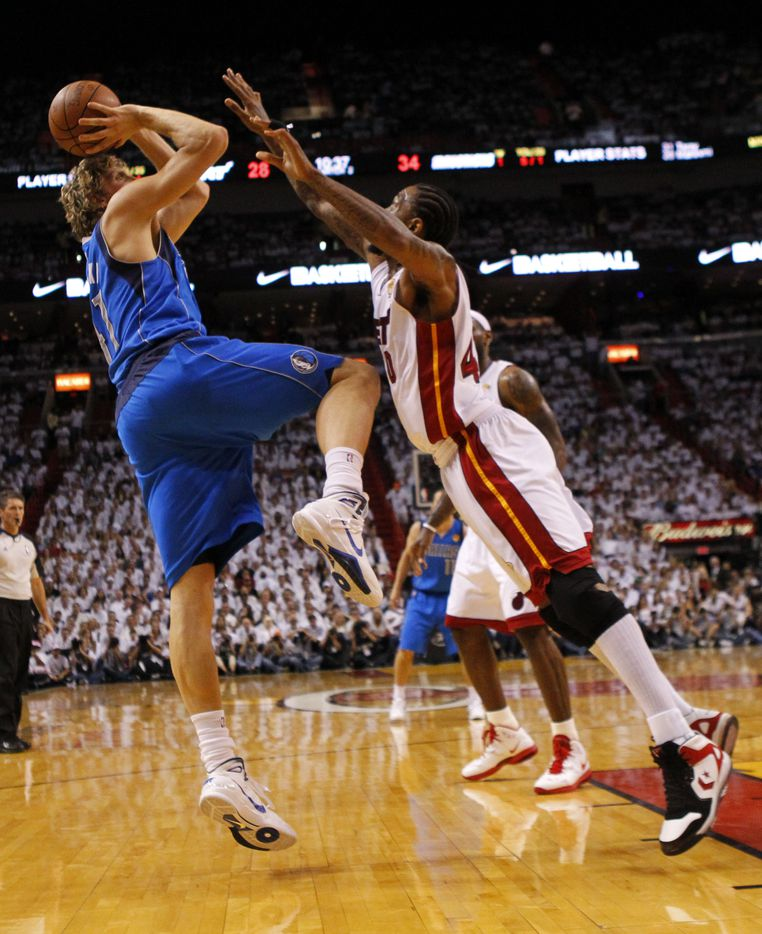 Dallas Mavericks power forward Dirk Nowitzki (41) shoots on Miami Heat power forward Udonis Haslem (40) during the second quarter of play in game six of the NBA Finals at American Airlines Arena Sunday, June 12, 2011 in Miami   (Tom Fox/The Dallas Morning News)