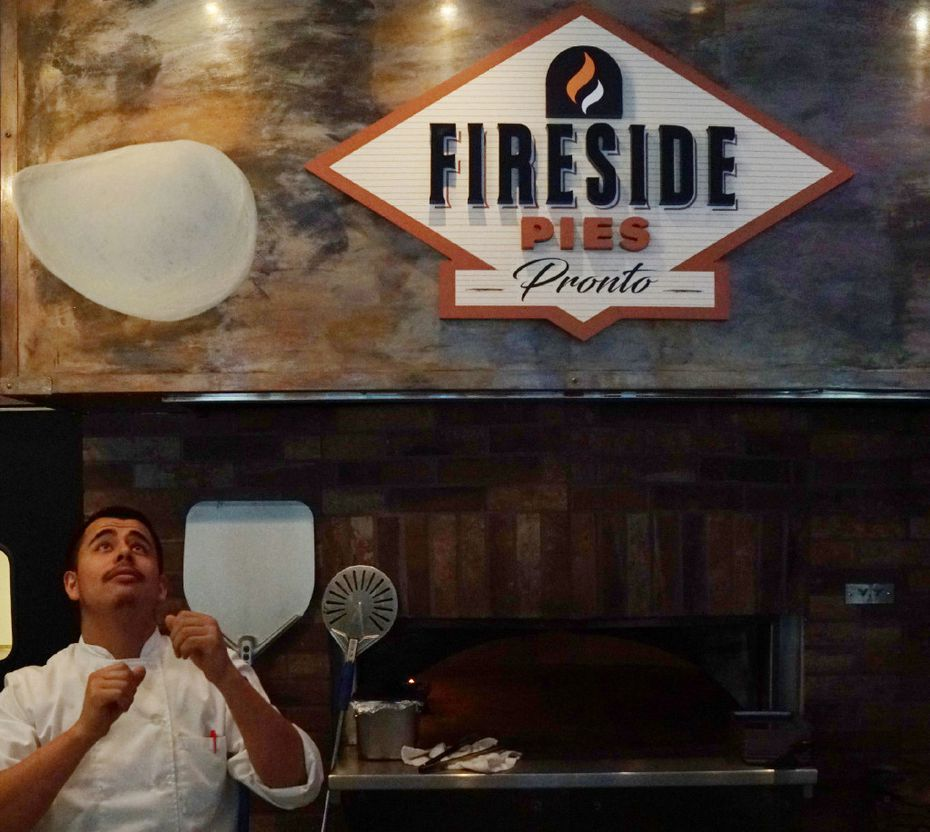 Fireside Pies chef Rafael Gonzalez prepared a pizza at Uptown Urban Market.