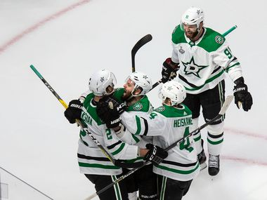 Jamie Oleksiak (2), Alexander Radulov (47), Miro Heiskanen (4) and Tyler Seguin (91) of the Dallas Stars celebrate a goal against the Tampa Bay Lightning during Game One of the Stanley Cup Final at Rogers Place in Edmonton, Alberta, Canada on Saturday, September 19, 2020.