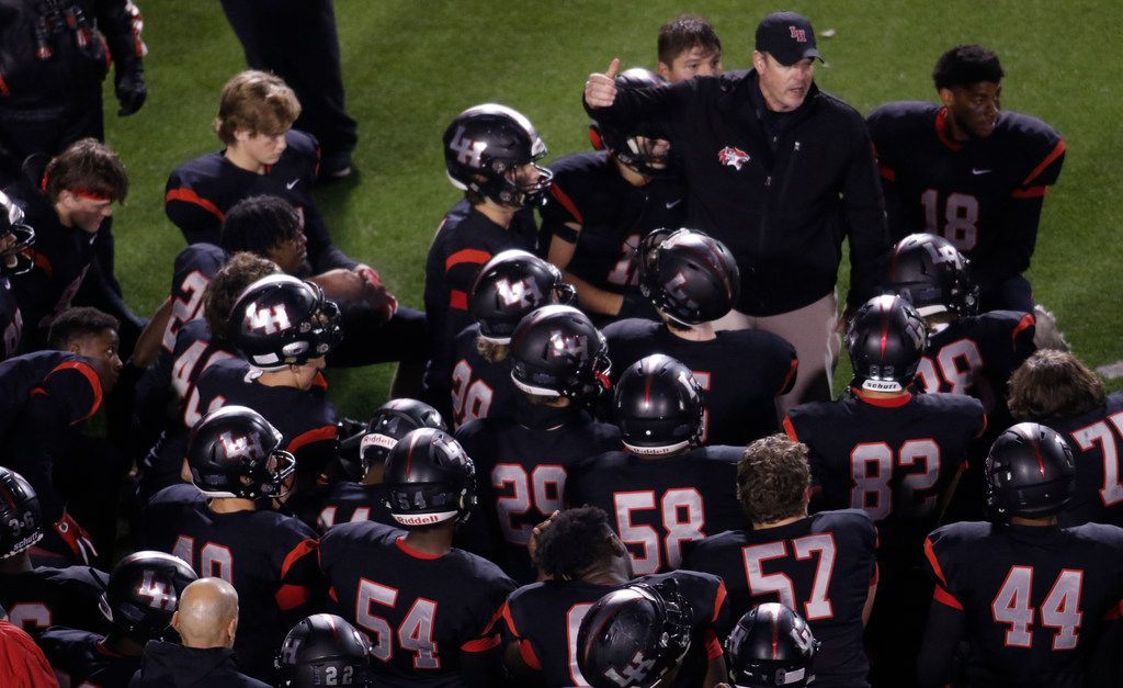Lake Highlands head coach Lonnie Jordan shares words of encouragement with his team following the Wildcats'  27-7 victory over Richardson. The two teams played their District 8-6A football game at Wildcat-Ram Stadium on the campus of Lake Highlands High School in Dallas on November 8, 2019. (Steve Hamm/ Special Contributor)