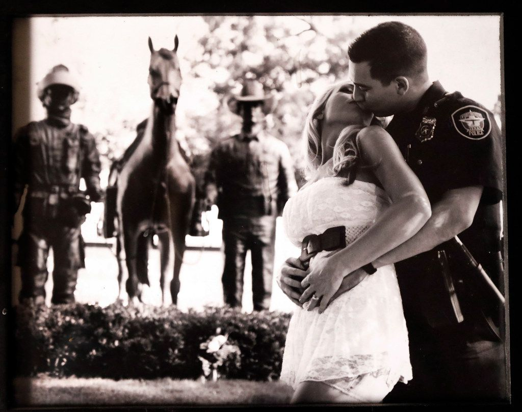 Jayme kisses her then-fiancé and Fort Worth police officer Brandon Magallon in an engagement photo. The two have been married 6 years. The Magallons of Burleson are one of many families who say they've considered divorce so that their sick or disabled children can be cared for through the unemployed parent's Medicaid. The situation is informally advised to many Texas families. Their 3 year-old daughter Annalynne suffers from cerebral palsy.
