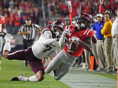 Mississippi wide receiver Braylon Sanders (13) attempts to catch a pass over Texas A&M defensive back Devin Morris (7) during the first half of an NCAA college football game in Oxford, Miss., Saturday, Oct. 19, 2019. (AP Photo/Thomas Graning)