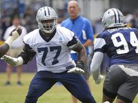 Dallas Cowboys tackle Tyron Smith (77) works against defensive end Randy Gregory (94) during a practice at training camp on Sunday, July 25, 2021, in Oxnard, Calif.