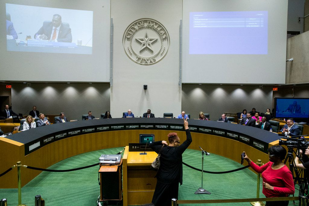 Dr. Pamela Grayson raises two fingers in the air during an open microphone session of the Dallas City Council meeting on Wednesday, September 12, 2018 at Dallas City Hall in Dallas. (Shaban Athuman/ The Dallas Morning News)