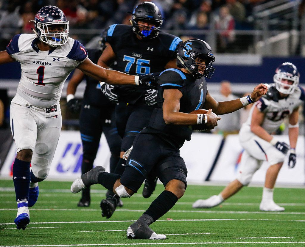 Denton Ryan's Ja'Tavion Sanders (1) holds Alvin Shadow Creek's quarterback Kyron Drones (1) in the second quarter of a Class 5A Division I state championship game at the AT&T Stadium in Arlington, on Friday, December 20, 2019. Shadow Creek leads at halftime 14-8. (Juan Figueroa/The Dallas Morning News)