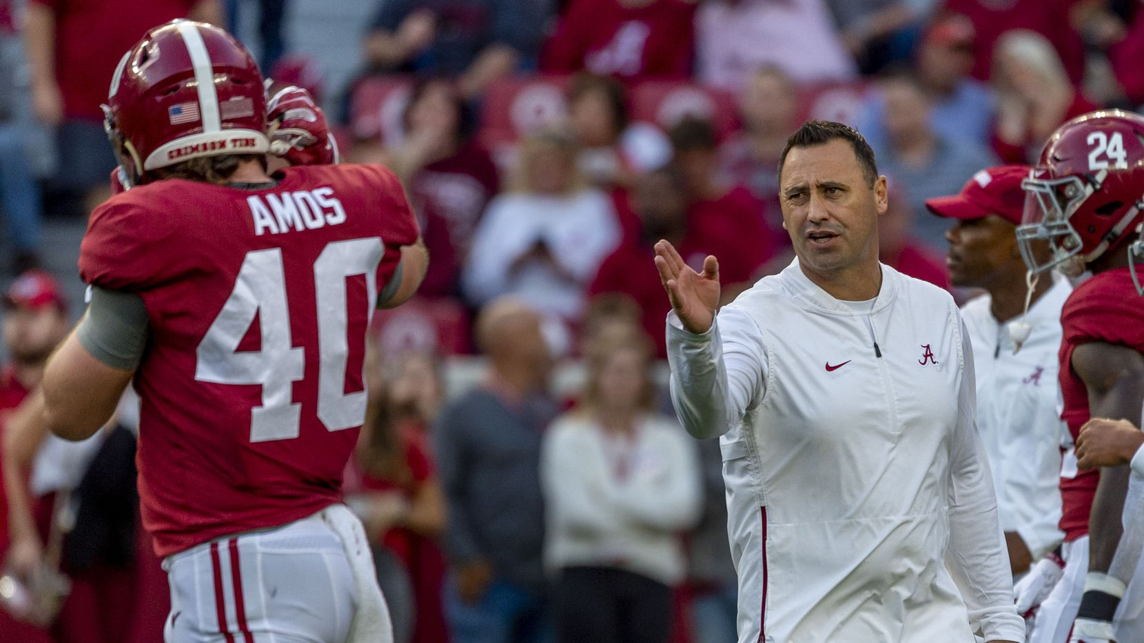 FILE - Alabama offensive coordinator Steve Sarkisian works with tight end Giles Amos (40) before a game against Arkansas on Saturday, Oct. 26, 2019, in Tuscaloosa, Ala.