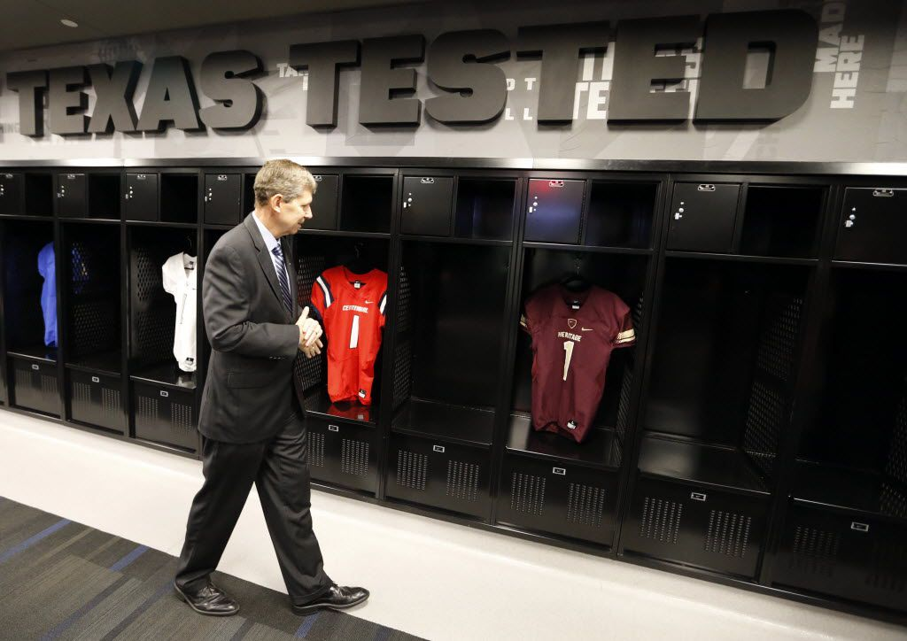Frisco ISD Superintendent Jeremy Lyon checks out the Nike-designed locker room and uniforms at the Ford Center.