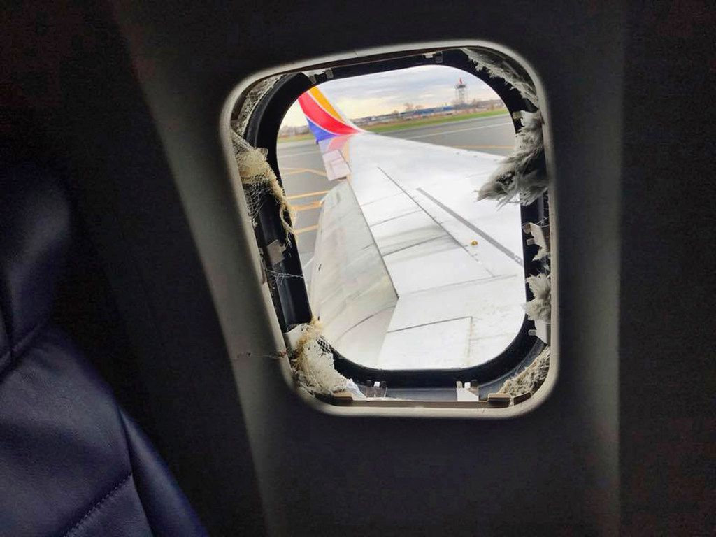 This April 17, 2018 photo provided by Marty Martinez shows the window that was shattered after a jet engine of a Southwest Airlines airplane failed at altitude, resulting in the death of a woman who was nearly sucked from the window during the flight of the Boeing 737 bound from New York to Dallas with 149 people aboard, shown after it made an emergency landing in Philadelphia. (Marty Martinez via AP)