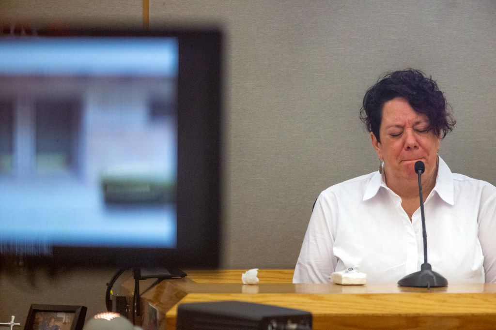 Amy Bascone Autrey pauses to collect herself during her testimony Monday morning.