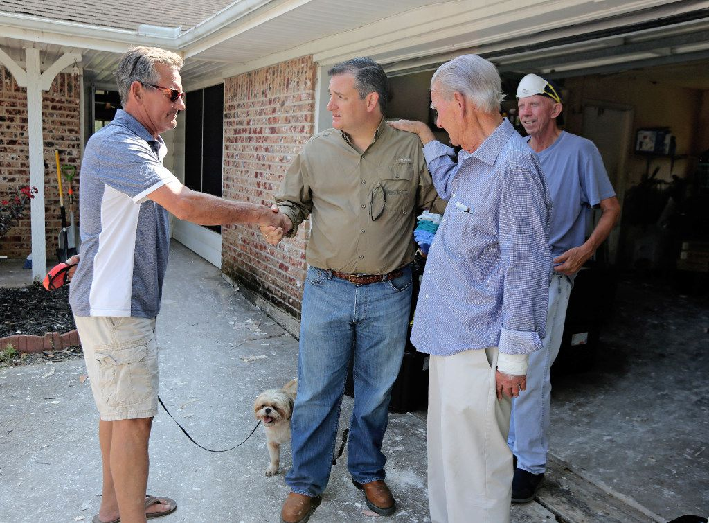 Timothy Moss, left, shakes hands with Ted Cruz, as Moss' father Travis Moss. and Jerry Collins, right,  talk with the senator during his visit to flood-damaged areas in Dickinson, Texas, on Saturday, September 9, 2017. (Louis DeLuca/The Dallas Morning News)