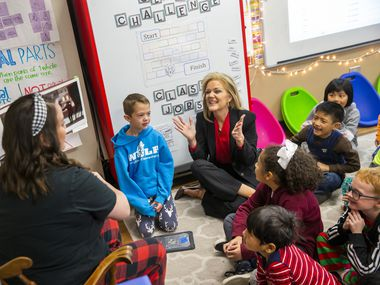 In this file photo, Richardson ISD Superintendent Jeannie Stone (center) reacts with students during a reading of The Polar Express in Kelly Kollaja's second grade classroom at Wallace Elementary School. (Lynda M. Gonzalez/The Dallas Morning News)