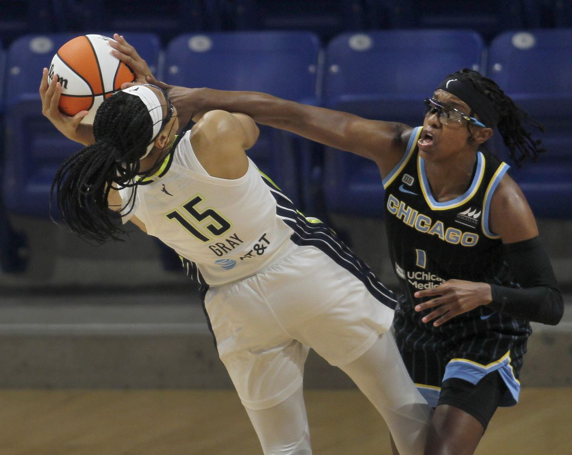 Dallas Wings guard Allisha Gray (15) is fouled by Chicago Sky guard Diamond DeShields (1) as she drove the lane to attempt a shot during first half action. The two WNBA teams played their game at College Park Center in Arlington on July 2, 2021. (Steve Hamm/ Special Contributor)