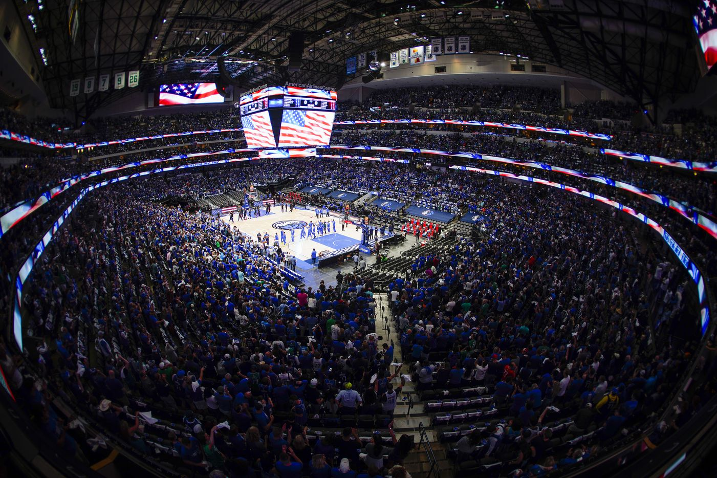 Fans and players stand for the national anthem before an NBA playoff basketball game between the Dallas Mavericks and the LA Clippers at American Airlines Center on Sunday, May 30, 2021, in Dallas.