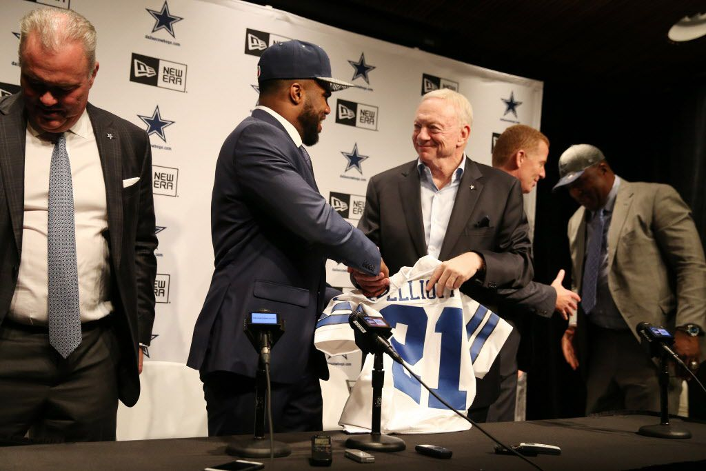 Running back Ezekiel Elliott, who played for Ohio State, shakes hands with Dallas Cowboys owner Jerry Jones after Elliottt was ntroduced by the team after being drafted fourth overall in the 2016 NFL draft by the Cowboys at the team's headquarters in Irving, Texas, Friday April 29, 2016. (Andy Jacobsohn/The Dallas Morning News)