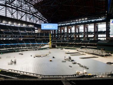 Flooring and a stage are assembled during an open house for the Texas Rangers' new Globe Life Field on Wednesday, March 11, 2020 in Arlington. The floor and stage are for an upcoming concert. (Ashley Landis/The Dallas Morning News)