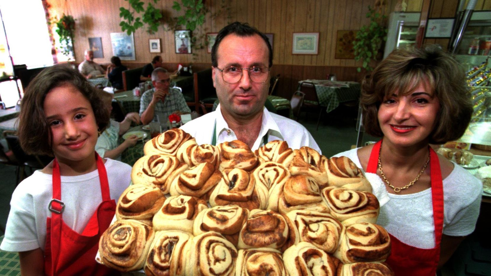 In this 2003 file photo, Tony Richa holds some fresh cinnamon rolls with his daughter Petra (left) and wife Lina at Tony's Cafe in Plano.