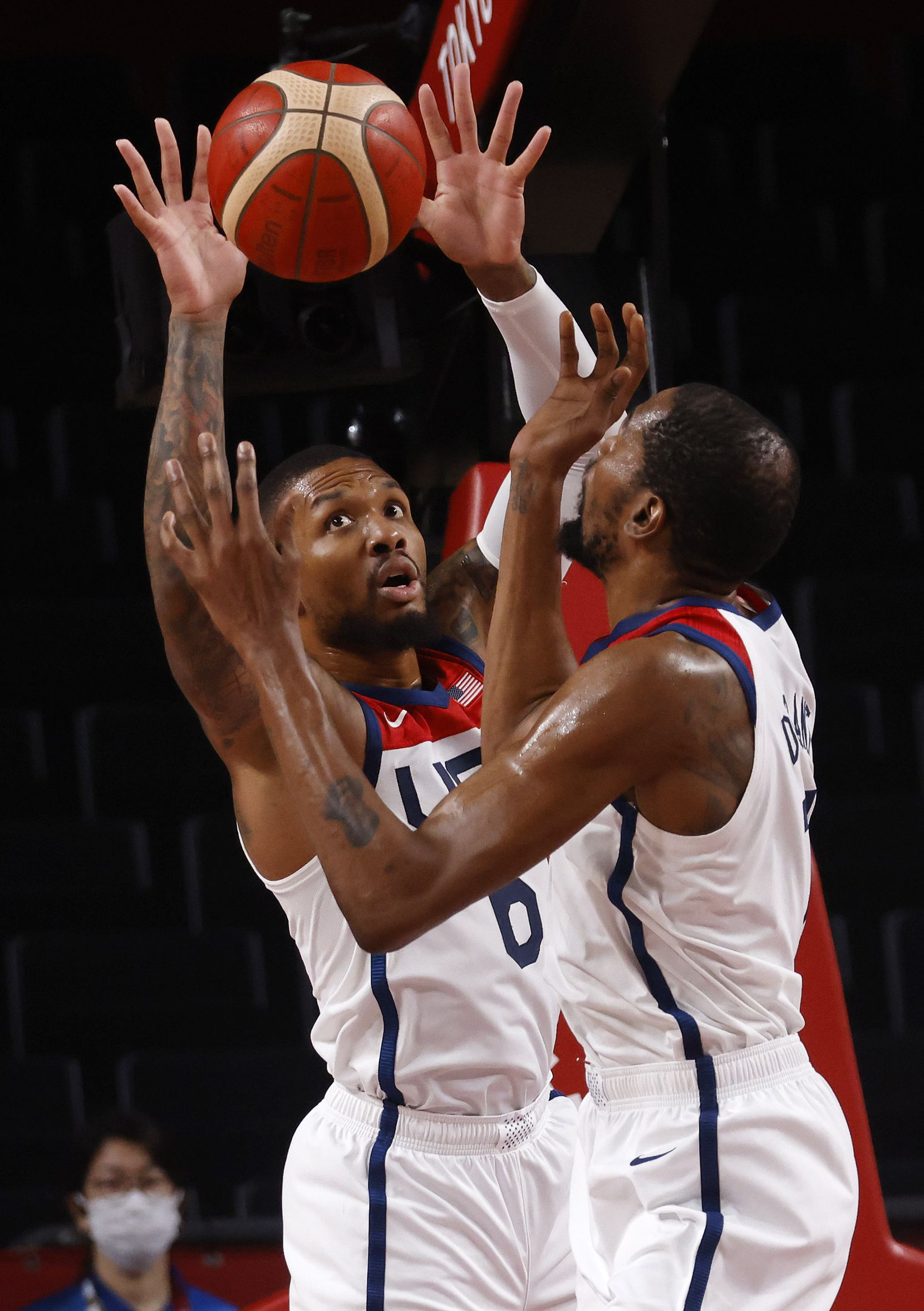 USA's Kevin Durant (7) and Damian Lillard (6) go up for a rebound in a game against Australia during the second half of a men's basketball semifinal at the postponed 2020 Tokyo Olympics at Saitama Super Arena, on Thursday, August 5, 2021, in Saitama, Japan. USA defeated Australia 97-78 to advance to the gold medal game. (Vernon Bryant/The Dallas Morning News)