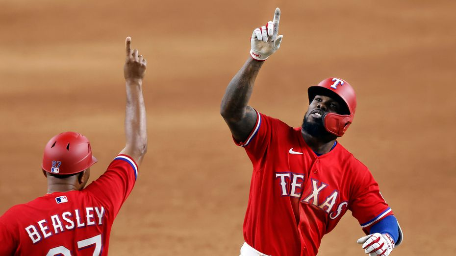Texas Rangers batter Adolis Garcia (right) celebrates his walk-off 3-run homer in the tenth inning Houston Astros at Globe Life Field in Arlington, Texas, Friday, May 21, 2021. It was the first walk-off home run in Globe Life Field history, winning 7-5.
