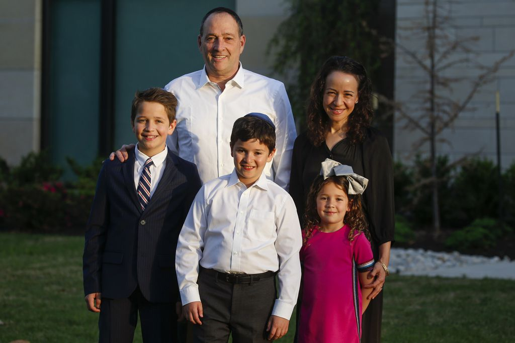 Jacques Ohayon, back left, and Audra Ohayon, back right, pose for a photograph with their kids Eli, front left, Ezra, and Erica, prior to taking part in a Passover Seder on Wednesday at their home in Dallas.