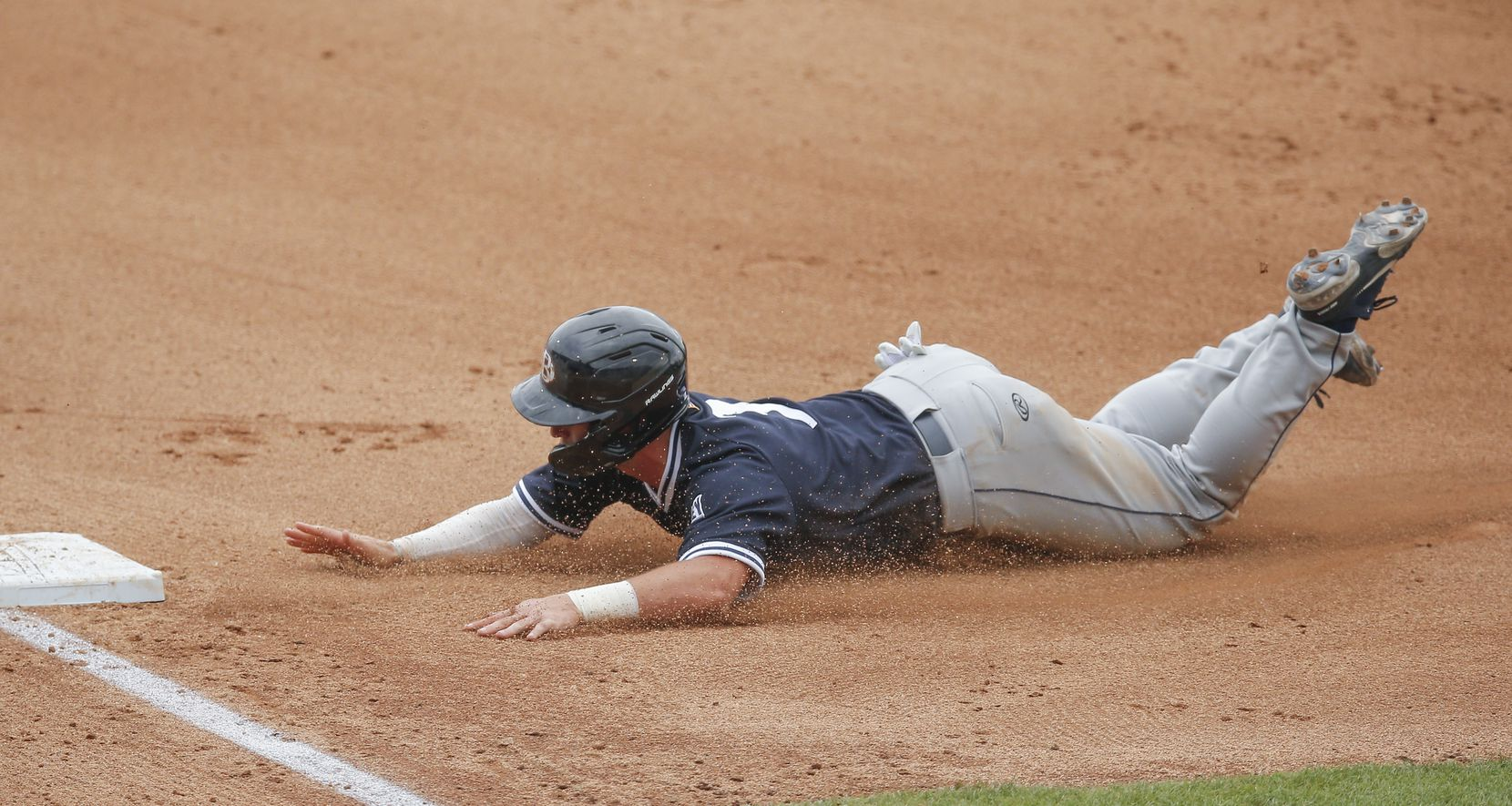 DBU's Jackson Glenn (3) dives into third in the fourth inning during the NCAA Fort Worth Regional baseball tournament against Oregon St. at TCU's Lupton Stadium in Fort Worth, Friday, June 4, 2021. Dallas Baptist won 6-5. (Brandon Wade/Special Contributor)