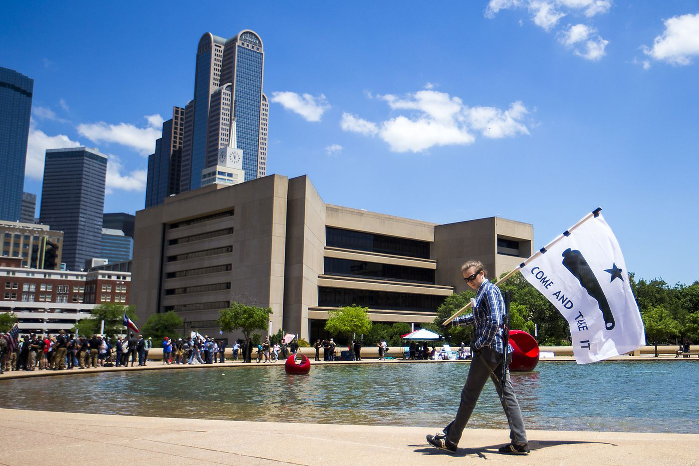 Gun rights advocate Thomas Bartram of Houston demonstrates outside Dallas City Hall at a rally organized by Open Carry Texas during the NRA Annual Meeting & Exhibits at the Kay Bailey Hutchison Convention Center on Saturday, May 5, 2018, in Dallas.