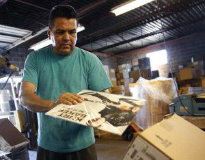 Lazaro Escobar packages a vinyl record at A&R. He too is among the small group of staffers at the pressing facility. (Rose Baca/Staff photographer)